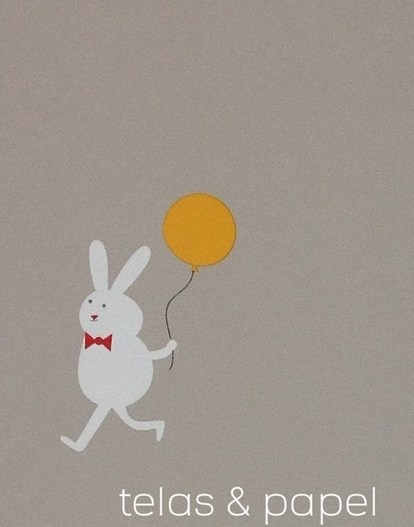 dibujo de conejito con globo sobre fondo color piedra